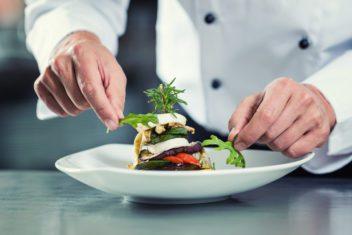 Chef in Restaurant garnishing vegetable dish